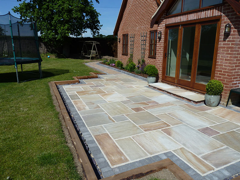 Gary Cooper Paving Sandstone Patio Edged With Charcoal