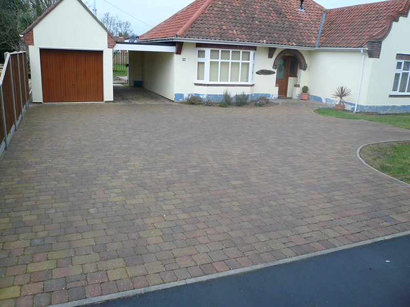 Autumn gold alpha setts with flat top path edging.