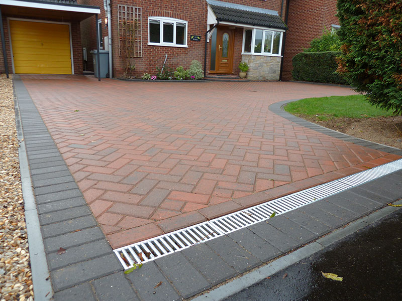 Gary Cooper Paving Brindle Omega With Charcoal Border